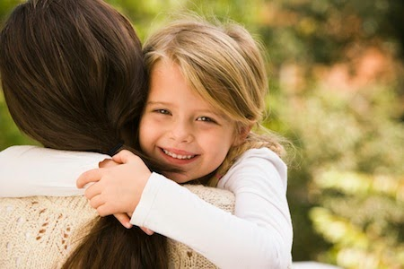 Girl hugging mother